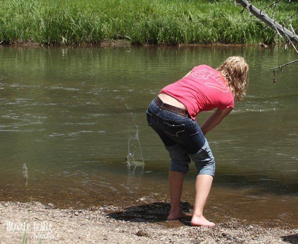 skipping stones to make ripples on a pond