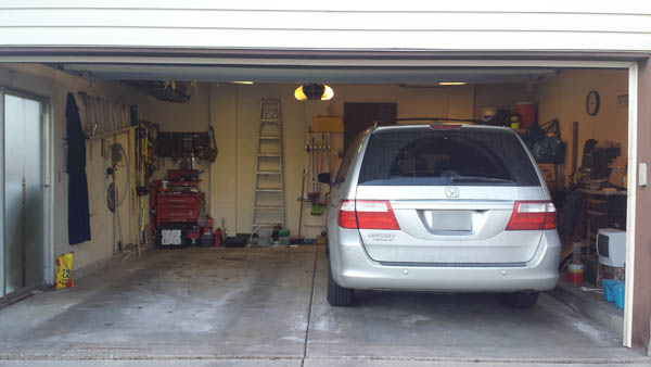Tips to get better garage storage and still fit your car - Inside of a garage ...