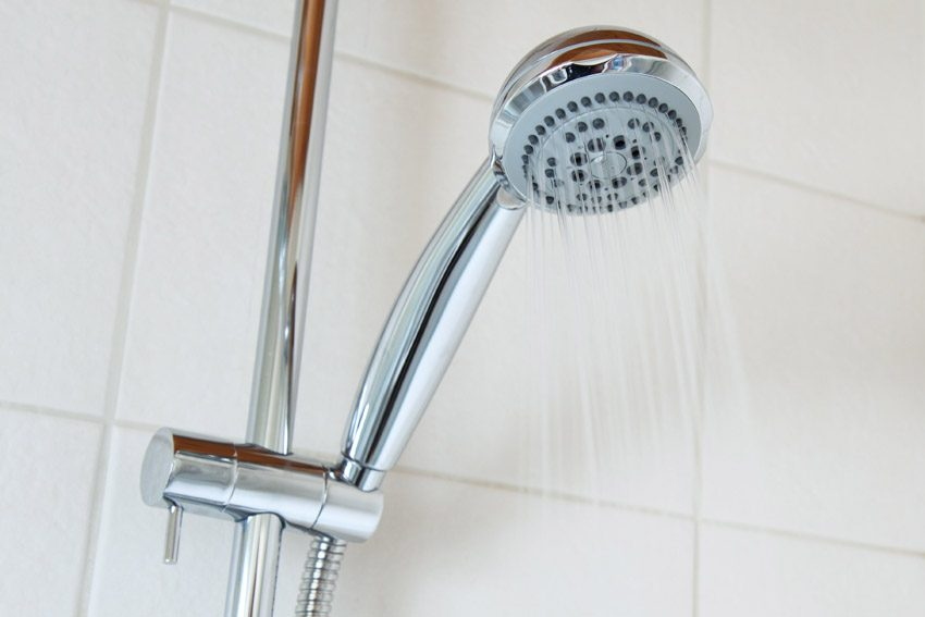 Use vinegar to clean showerheads and faucets