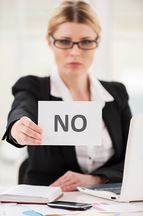 Rejection. Serious mature woman in formalwear saying no to you w