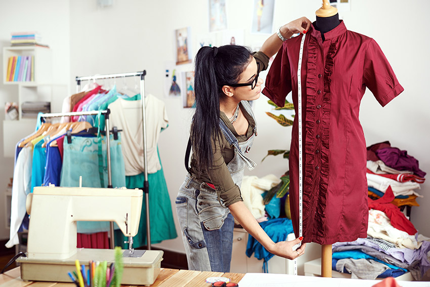entrepreneur running her sewing business from home